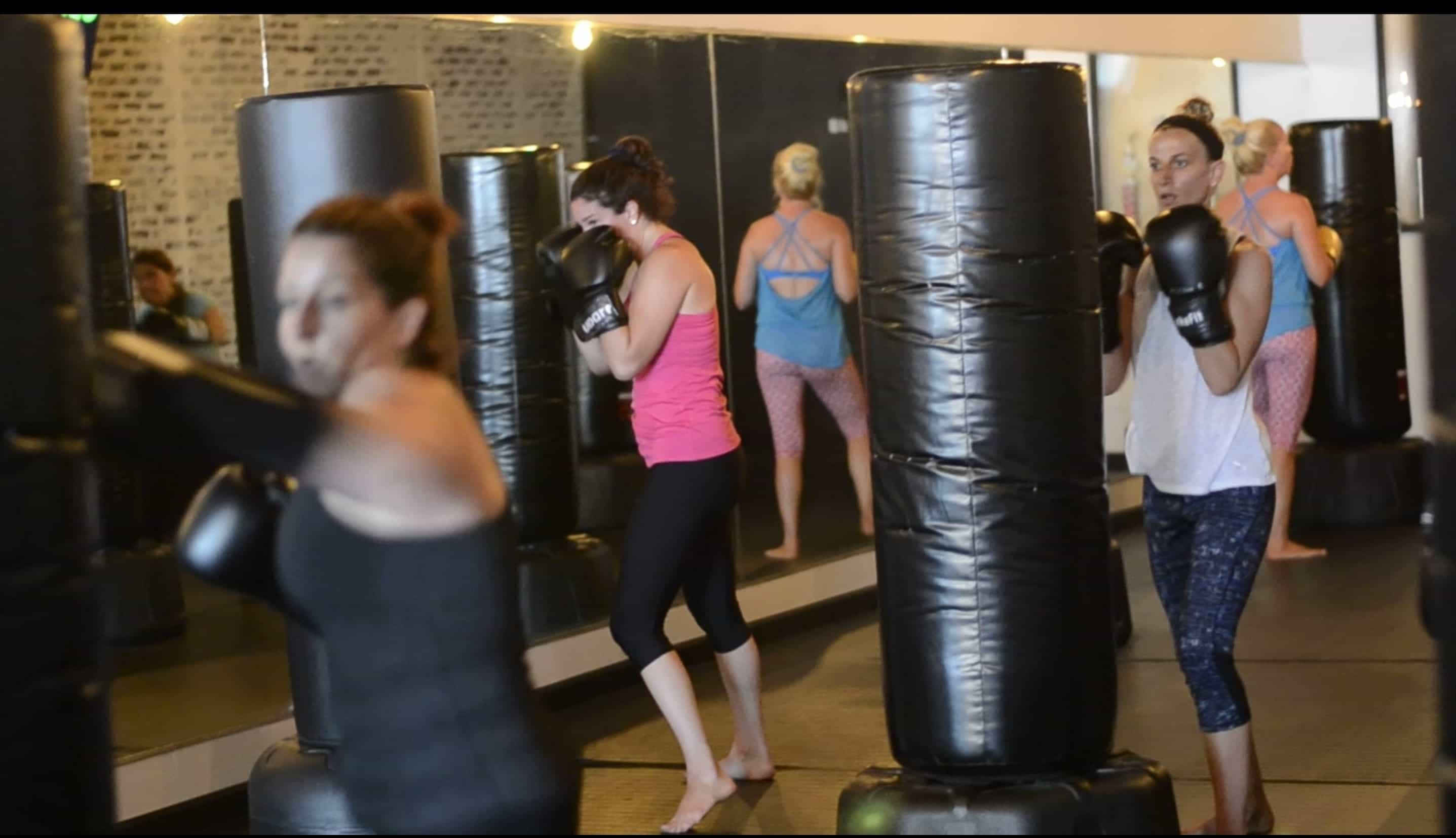 women catching their breather between rounds at udar kickboxing class in long beach ny