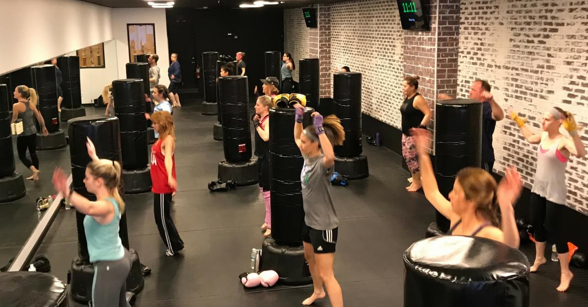 group of people doing jumping jacks at udar kickboxing class in long beach ny